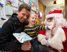 "Santa and ""little helpers"" from the River Lee Hotel pay a special Christmas visit to St. Anne's Children's Ward at The Mercy"